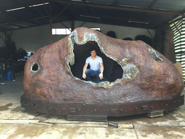 The largest known amethyst geode from Uruguay weighing over 44,000 lbs and measuring 18 feet wide.