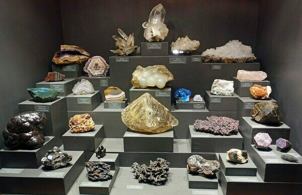 A collection of minerals.  These would all either be considered crystals themselves or are made up of crystals.