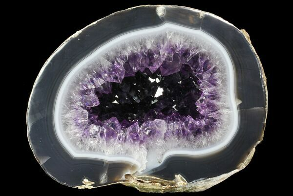 A cut & polished amethyst geode from Uruguay showing the layers of chalcedony that built up prior to crystal formation.